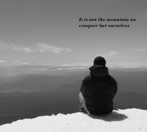 alone-on-a-moutain-top-black-and-white-with-tagline